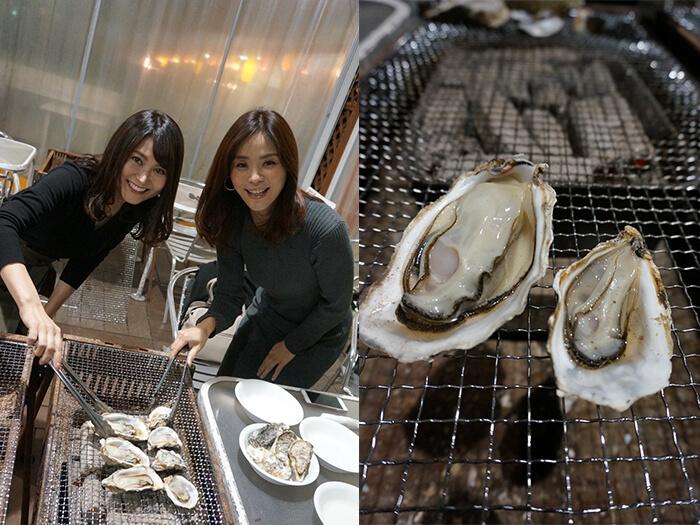 女性2人がトングで牡蠣を挟んでいる
